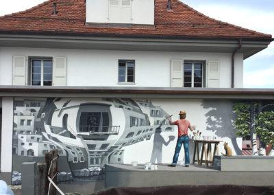 Peintre devant le mur - fresque trompe l'oeil - Thierrens (VD)